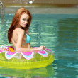 Sexy brunette woman in a floating water toy — Stock Photo