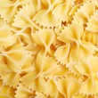 Uncooked bow tie pasta — Stock Photo
