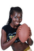 Sexy female holding a football — Stock Photo