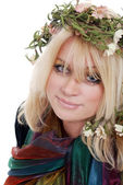 Young blond woman wearing a laurel wreath — Stockfoto
