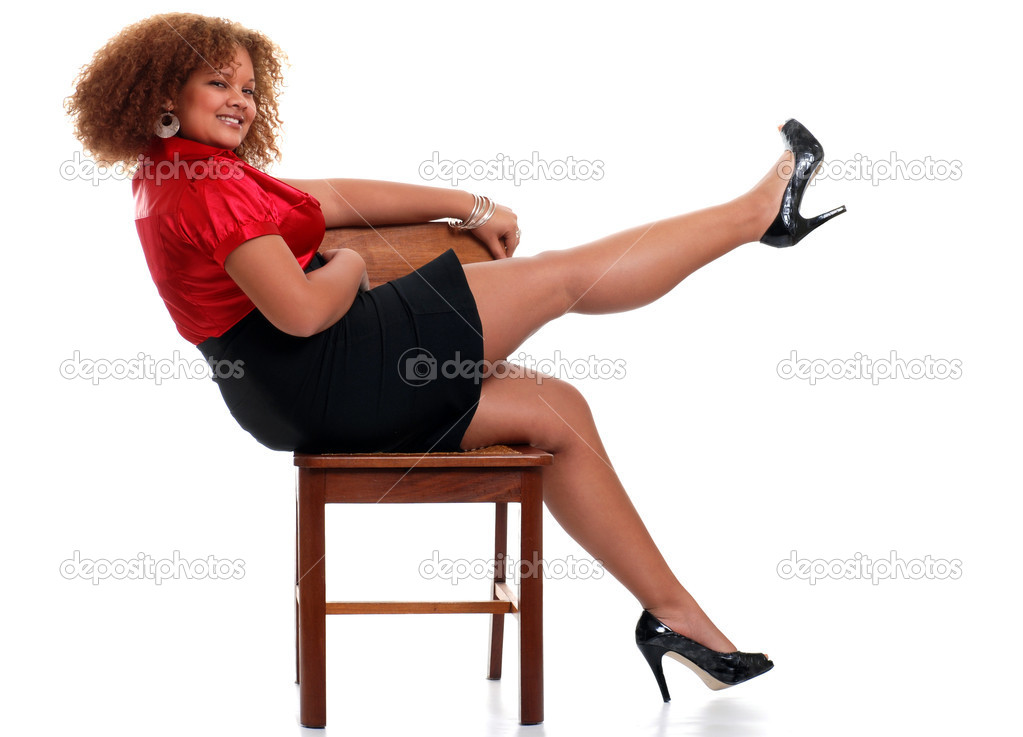 sexy african woman on a chair lifting her leg stock. Black Bedroom Furniture Sets. Home Design Ideas