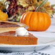 Pumpkin pie and whip cream - Stock Photo