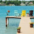 Stock Photo: Quite dock with colorful chairs and decorations