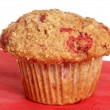 Raspberry whole wheat muffin on red napkin — Stock Photo
