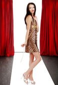 Model wearing animal print dress on the catwalk — Stock Photo