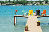 Quite dock with colorful chairs and decorations — Stock Photo