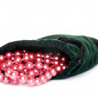 Pink pearls in a green bag — Stock Photo #3892685