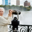 Senior surprised at niagara falls binoculars — Stock Photo