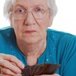 Senior woman holding playing cards — Stock Photo