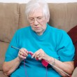 Senior woman knitting — Stock Photo
