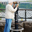 Senior woman looking at the rainbow bridge — Stock Photo