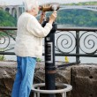 Stock Photo: Senior womlooking at rainbow bridge