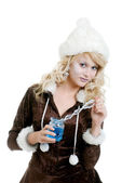 Ice princess holding an icicle wand and crystal glass — Stock Photo