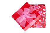 Opened valentines gift box with bow — Stock Photo