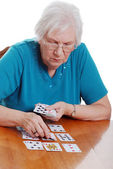 Senior woman playing cards — Stock Photo