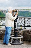 Senior woman looking at the rainbow bridge — Stock Photo