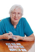 Senior woman playing solitaire — Stock Photo