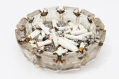 A lot of smoke ashtray on a white backgr — Stock Photo