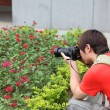 Stock Photo: Younger Photographer shot flower