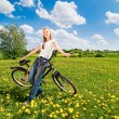 Shoot of young woman with bicycle — Stock Photo #3177835