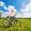 Shoot of young woman with bicycle — Stock Photo