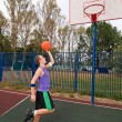 Young men playing street basketball at court playground — Stock Photo #3648347