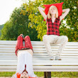 Two teenage girls have fun at the summer park - Stock Photo