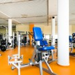 Stock Photo: Interior of health club with some exercise equipment