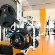 Interior of a health club with some exercise equipment — Stock Photo #3673427