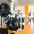 Interior of a health club with some exercise equipment - Stock Photo