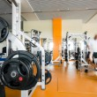 Stock Photo: Weight training at gym with instructor help