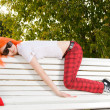 Stock Photo: Teenage girl relaxing at summer park