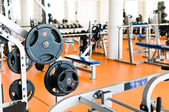Weight training at the gym with instructor help — Stock Photo