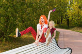 Two teenage girls have fun at the summer park — Stock Photo