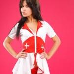 Sensual brunette nurse posing on color background — Stock Photo #3758014