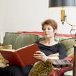 Stock Photo: Woman with a book