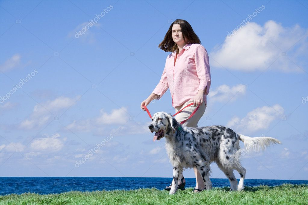 Outdoors portrait of a girl walking her dog near the sea. — Stock Photo #2718089