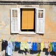 Window and laundry - Stok fotoğraf