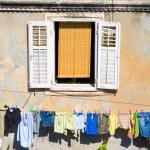 Window and laundry — Stock Photo #3256994