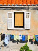 Window and laundry — Stock Photo