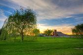 Sunset on the farm — Stock Photo