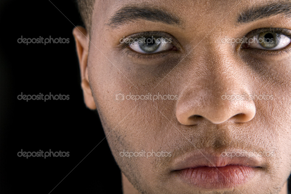 Portrait of a handsome young black man with dark background — Stock Photo #3523245