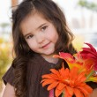 Foto de Stock  : Little girl with flowers