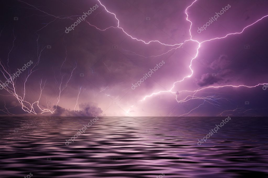 Multiple lightning bolts reflected in the open sea — Stock Photo #3543879
