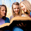 Stock Photo: Family Reading Bible Together