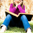 Stock Photo: Young Girl Reading the Bible