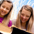 Sisters Reading Together — Stock Photo