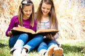 Sisters Reading the Bible — Stock Photo