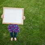 Girl Holding Small Blank Frame — Stock Photo #2952210