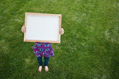 Girl Holding Small Blank Frame — Stock Photo
